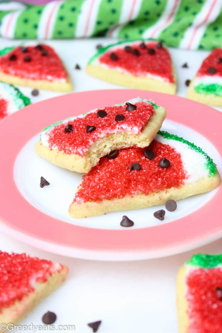 Soft Sugar cookies made with sour cream decorated as watermelon cookies.