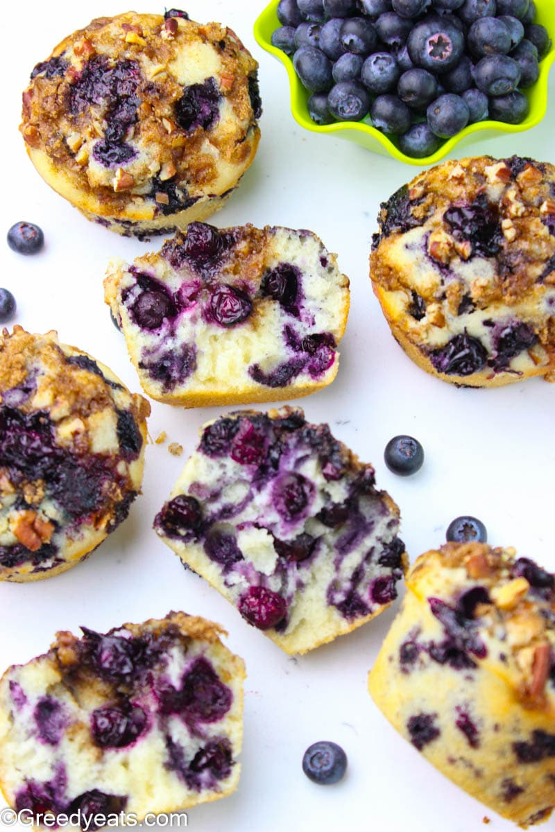 Blueberry Streusel Muffins with juicy blueberries kept on a white borad.