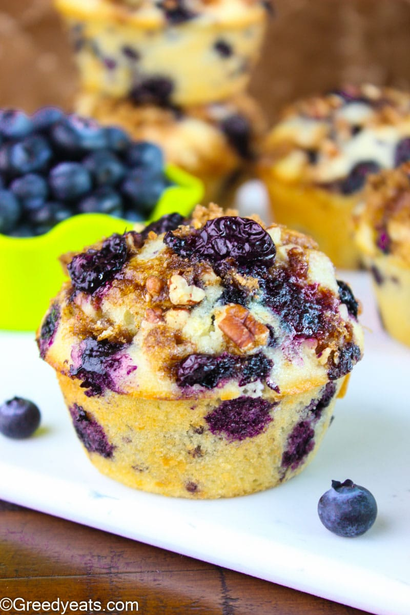 Tall and fluffy Blueberry Streusel Muffins filled with sweet and juicy berries.