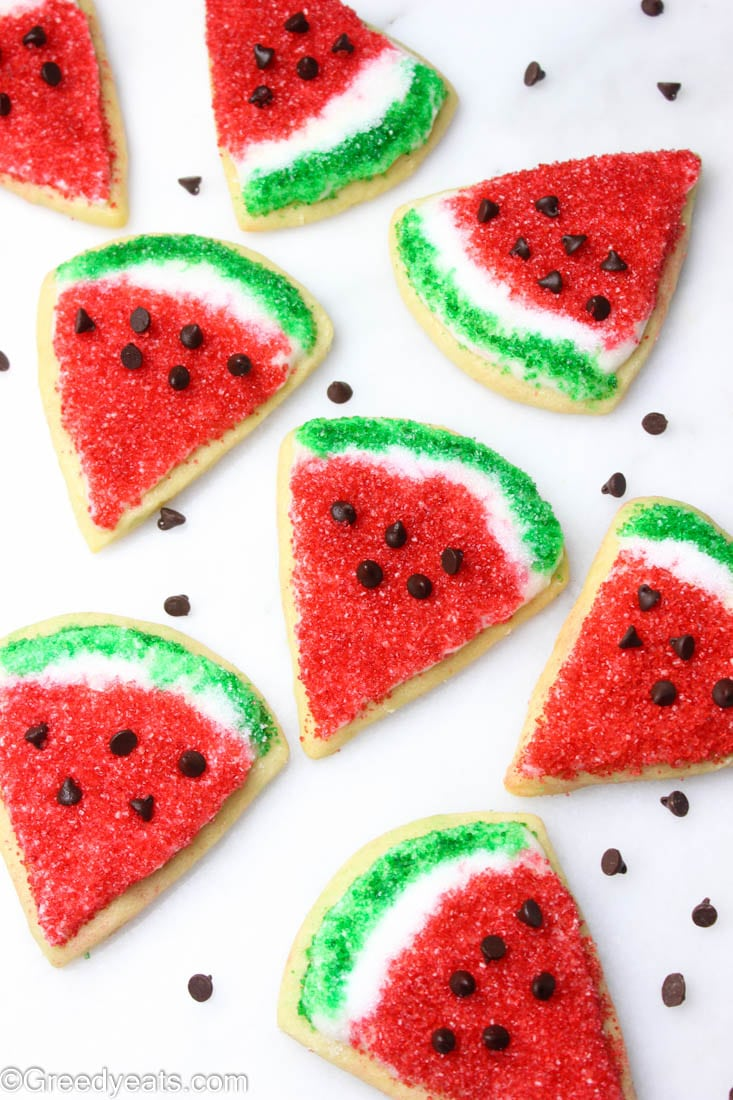 Watermelon slice cookies sprinkled with read and green sanding sugar.
