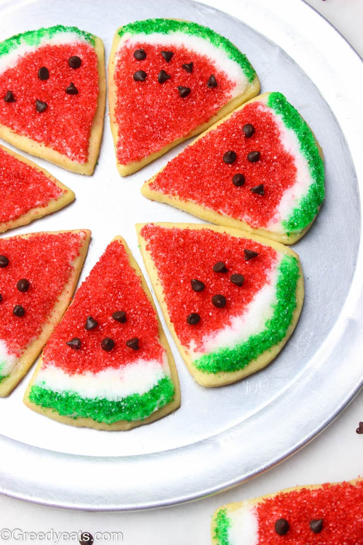 Easy Watermelon cookies decorated with sanding sugar and mini chocolate chips.