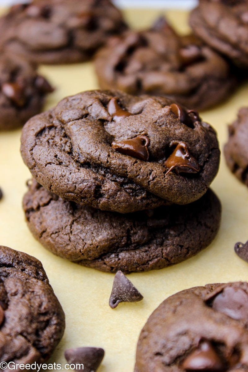 Thick and soft Double Chocolate cream cheese cookies kept on parchment paper.