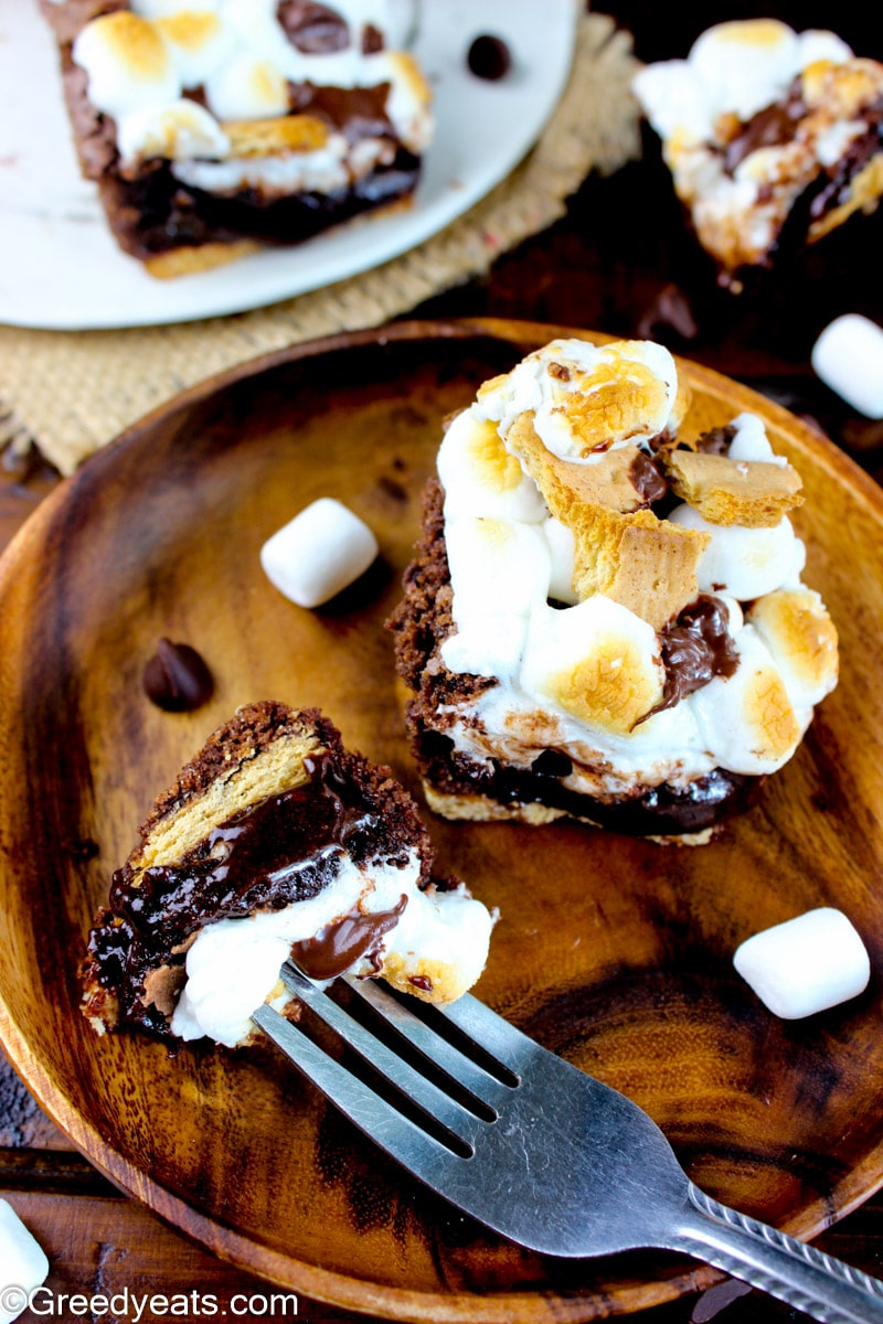 Homemade Smores Brownies recipe served on a brown wooden plate.