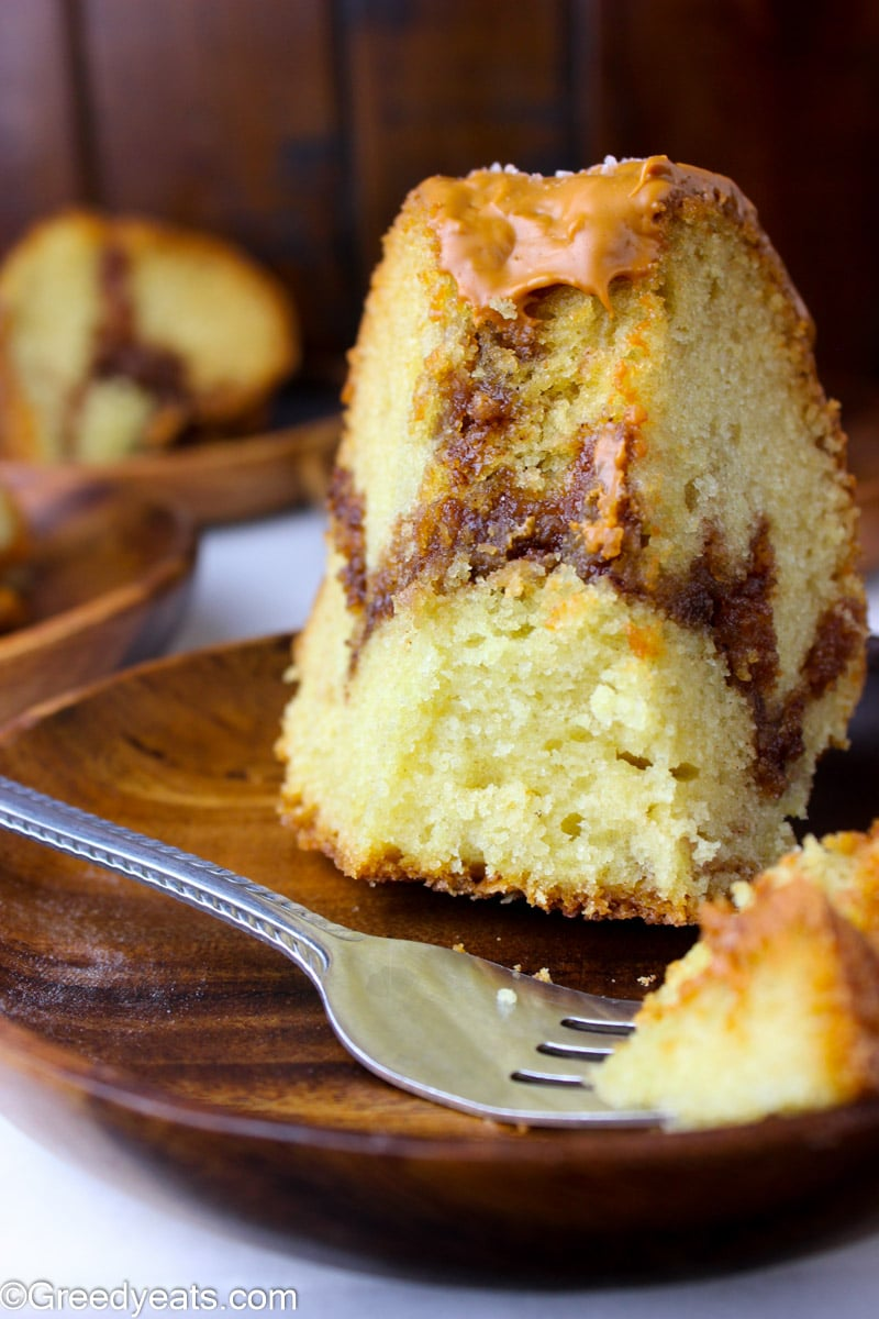 Easy Cinnamon Bundt Cake slice with gooey and thick cinnamon swirl.
