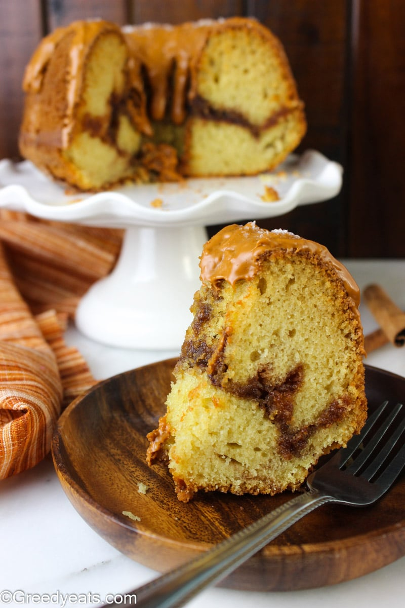 Moist and tender slice of cinnamon bundt cake topped with Caramel Brown sugar glaze!