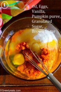 Wet ingredients like canned pumpkin, oil, sugar and eggs for making the easiest Pumpkin Bars ever!