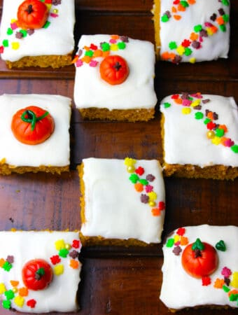 Best Pumpkin Bars slathered with easy cream cheese frosting recipe, topped with fall sprinkles!