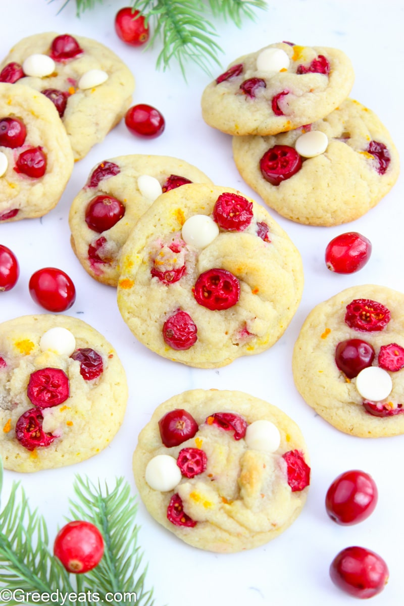 Freshly Baked Cranberry Orange Cookies topped with fresh cranberries and white chocolate chips.