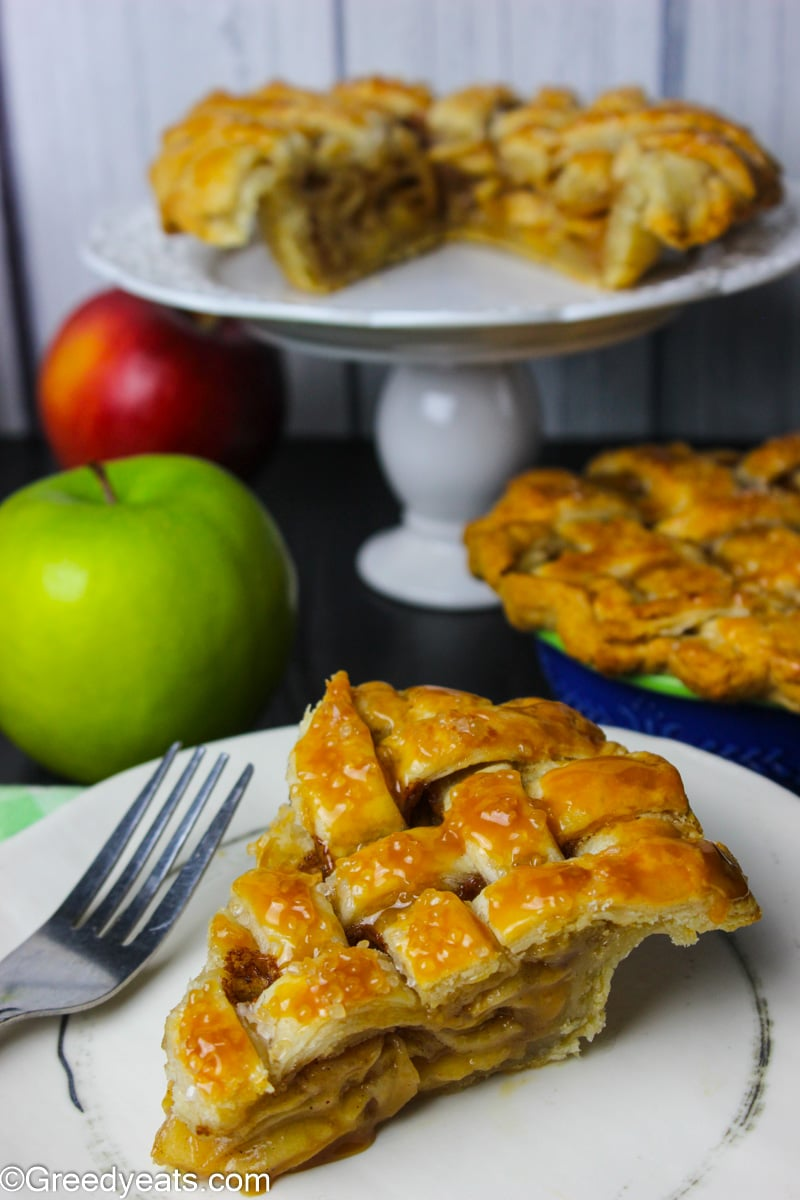 Easy Mini Apple Pie recipe slice that is flaky, buttery and drizzled with caramel on top!