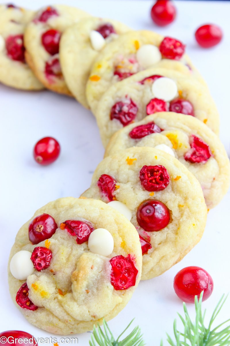 Soft and chewy white chocolate Cranberry Cookies with fresh cranberries studded on top.