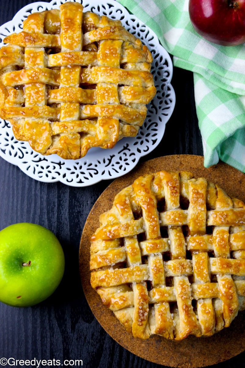Two mini Apple Pies baked in 5 inches pie dishes, sprinkles with coarse sugar.