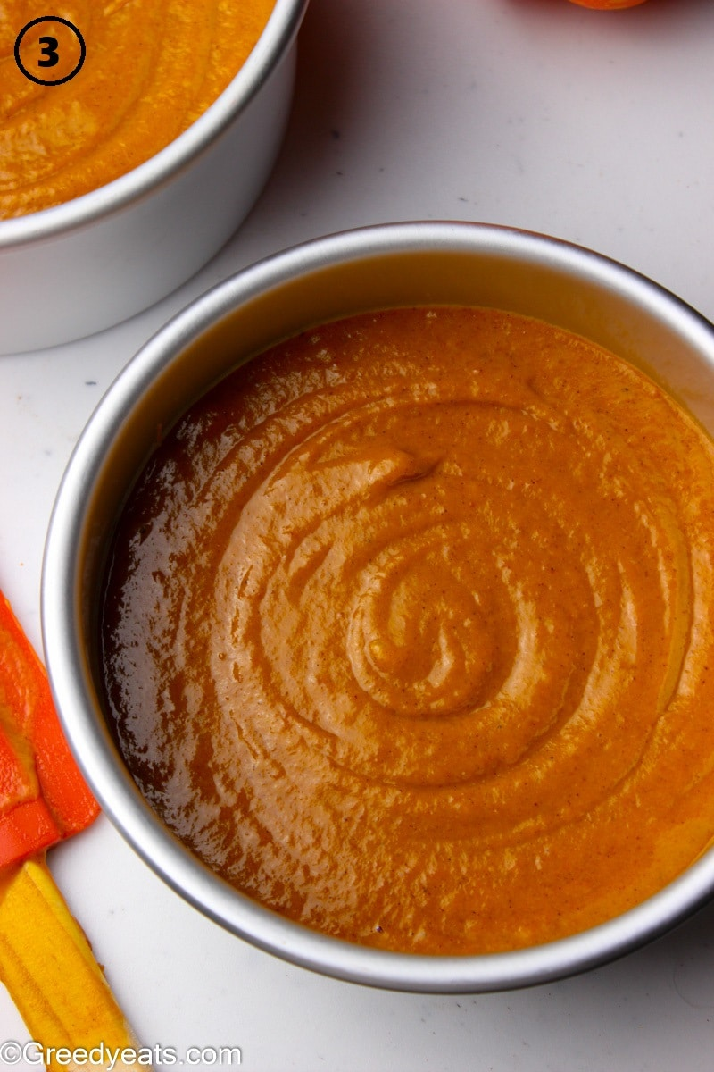 Pumpkin cake batter ready to be baked in 9 inches cake pan.