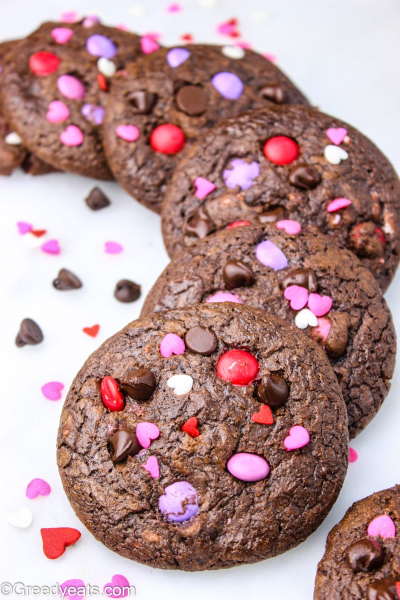 M&m Chocolate Chip Cookies stuffed with pink and red m&ms and chocolate chips.