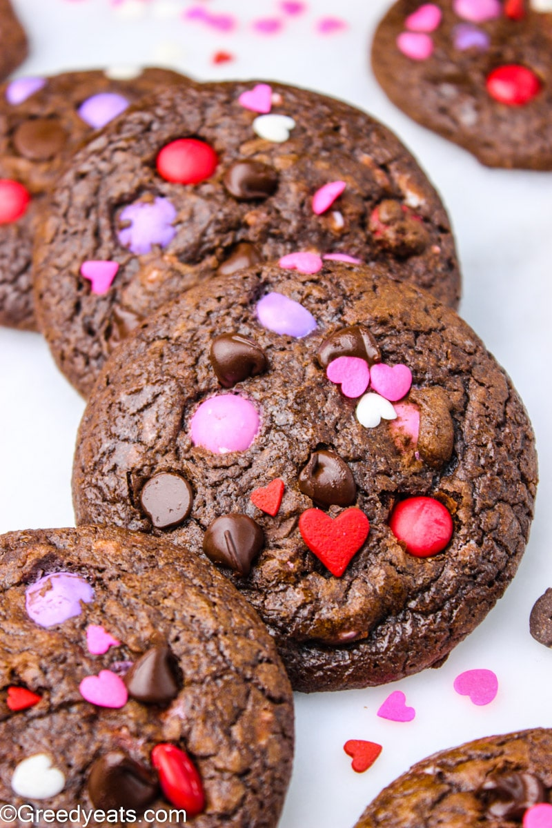 Chocolate m&m cookies topped with valentines m&ms and chocolate chips.
