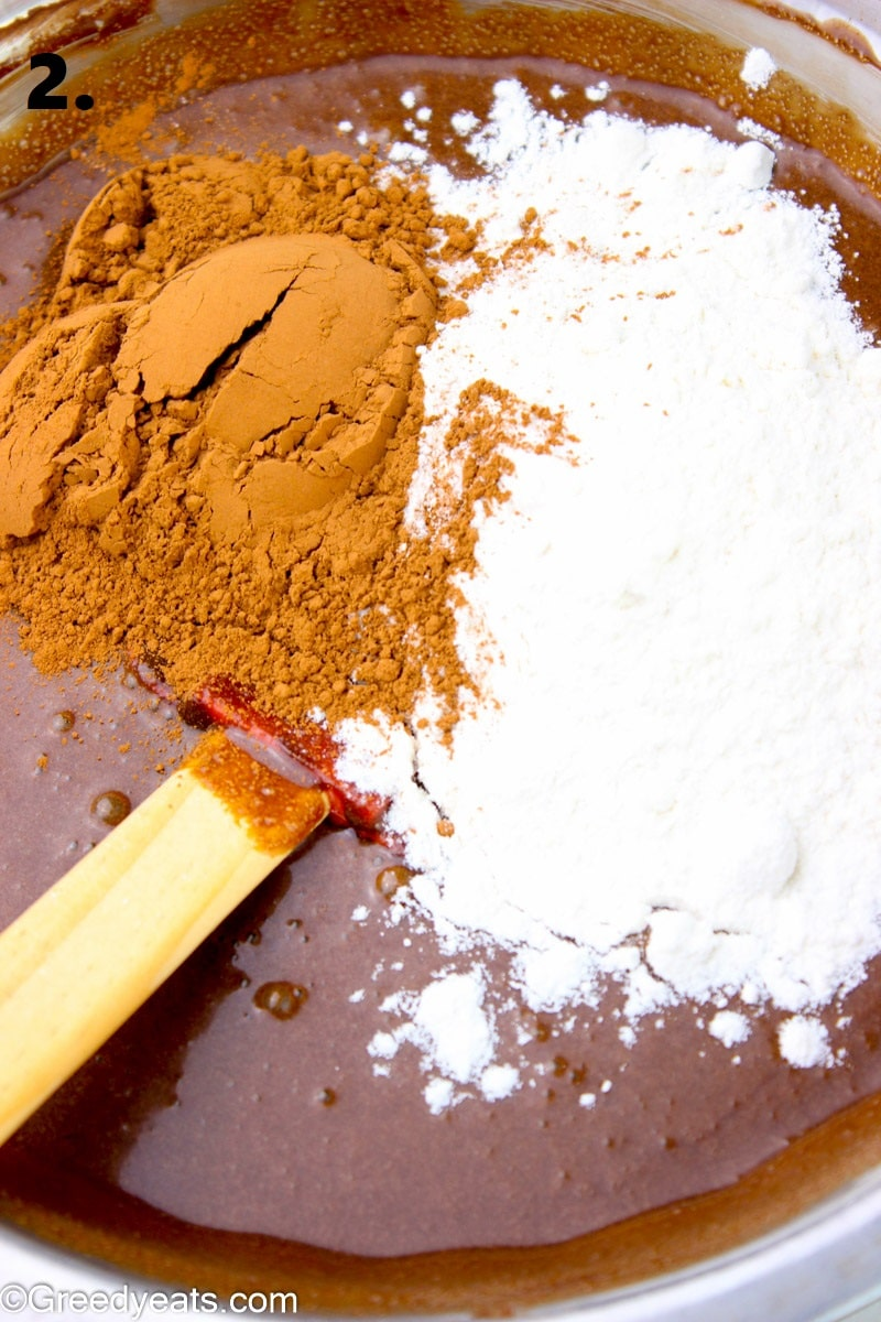 Mixing dry ingredients into wet for chocolate cookie dough.
