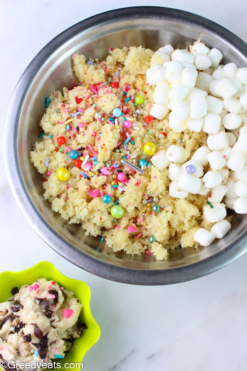 Vanilla Cake, marshmallows and sprinkles to make cake popsicles.