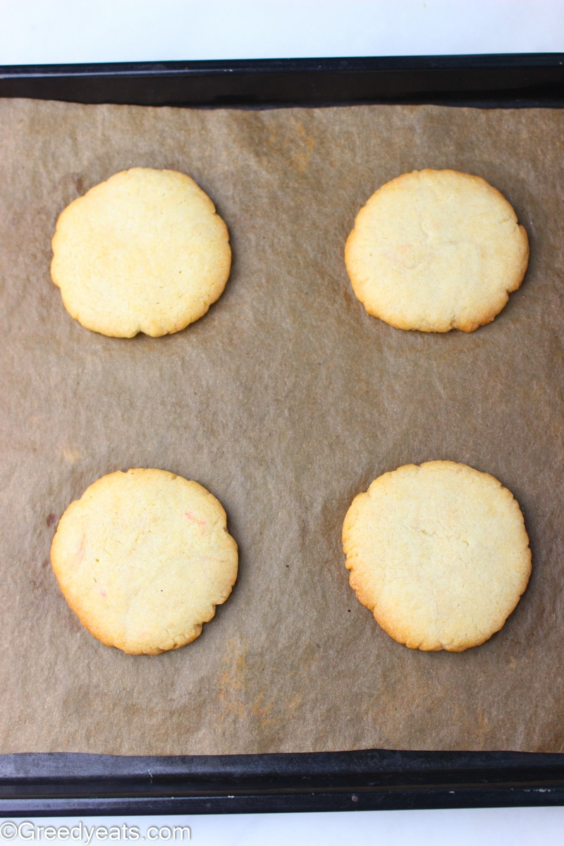 Freshly baked Sugar Cookies with golden edges and soft centers.