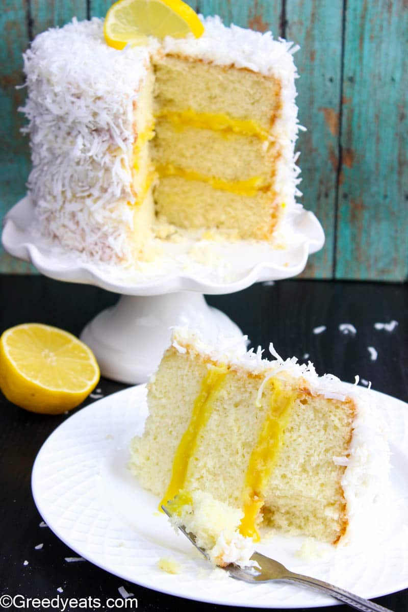 Coconut Cake with lemon curd topped with cream cheese frosting and sweetened shredded coconut.