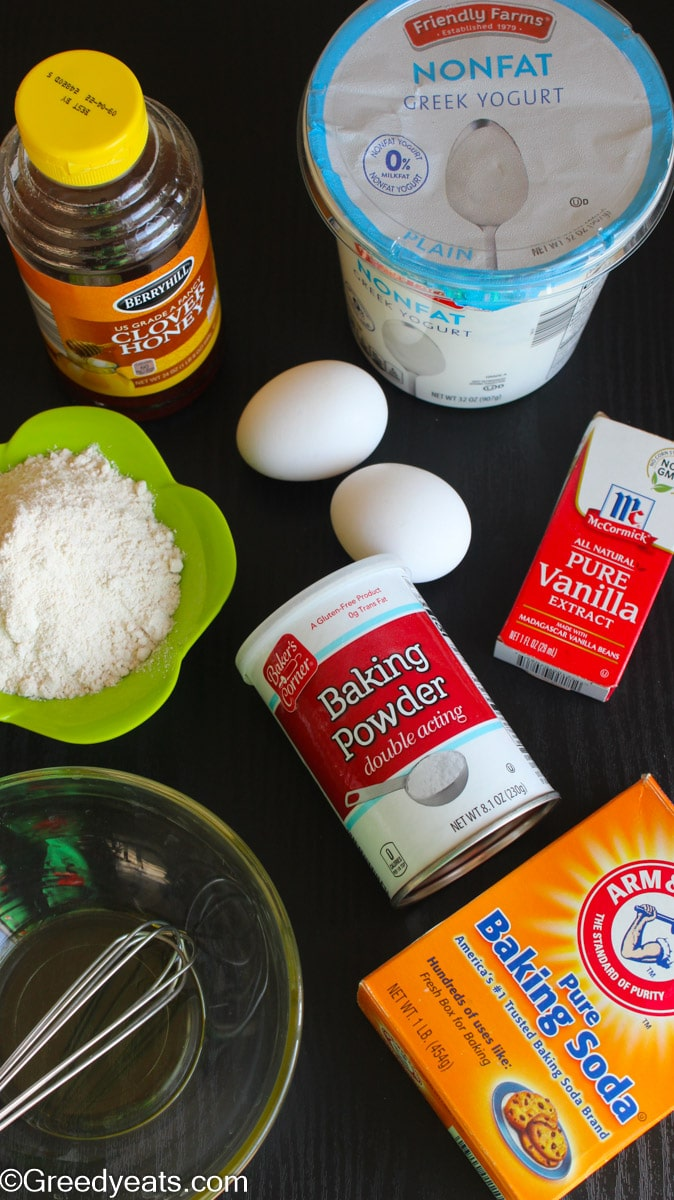 Ingredients like flour, coconut oil, eggs and honey used to make healthy breakfast pancakes.
