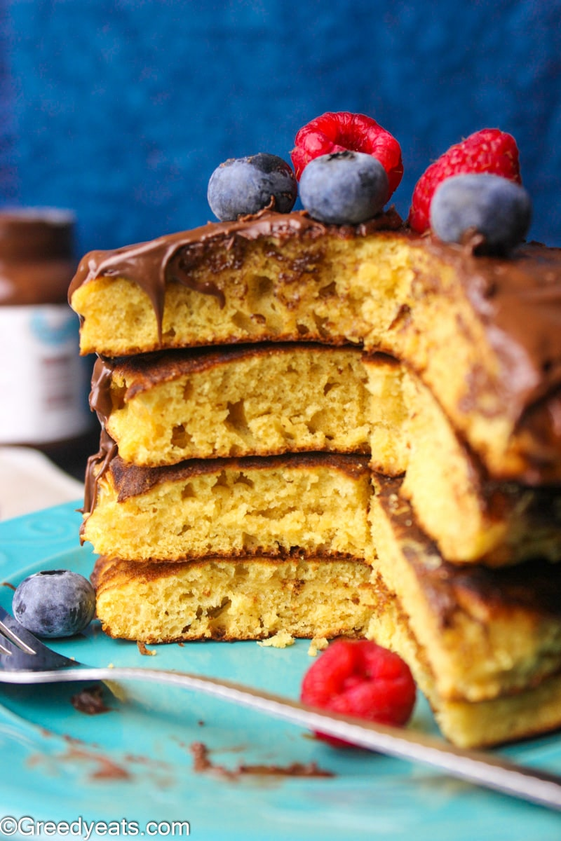Light, soft and healthy Pancake Recipe topped with chocolate spread and fresh berries.