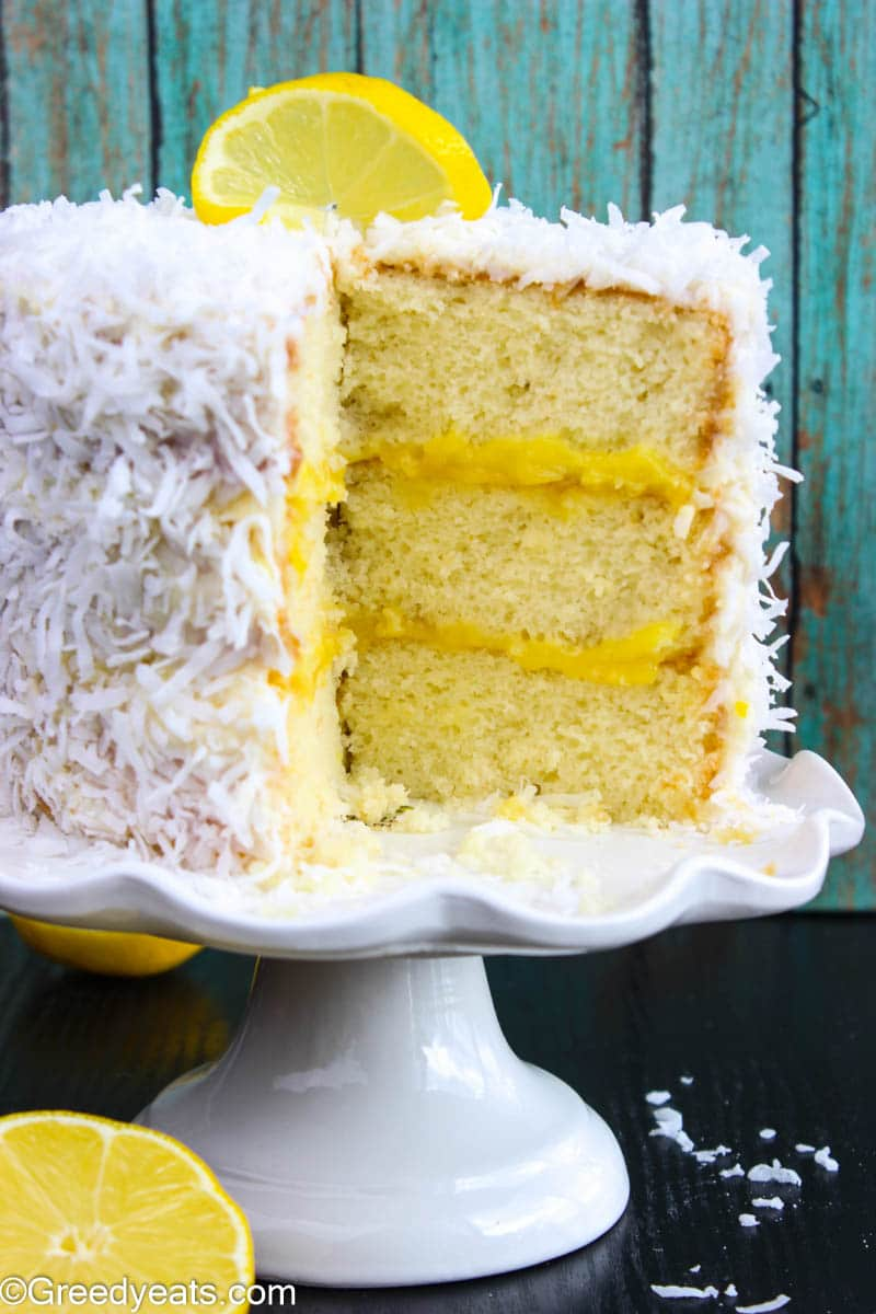 Coconut cake layered with fresh lemon curd and topped with with cream cheese frosting.