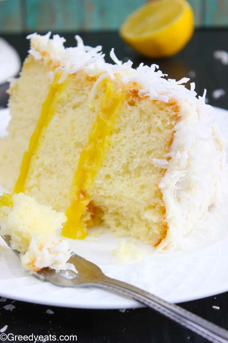 Soft Lemon Curd Cake Slice filled with homemade lemon curd and topped with cream cheese frosting.