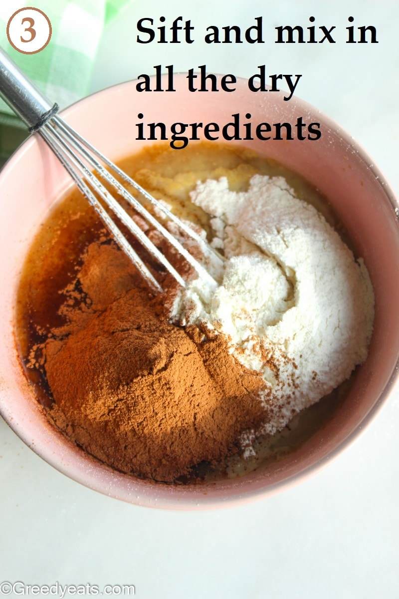 Mixing dry ingredients into wet to make chocolate cake.