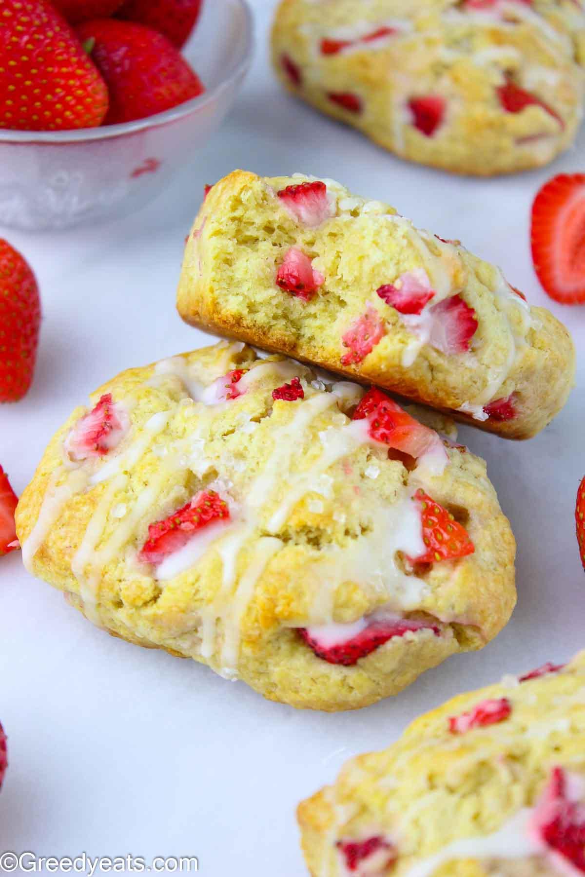 Easy Strawberry Scones recipe topped with sparkling sugar and vanilla glaze.