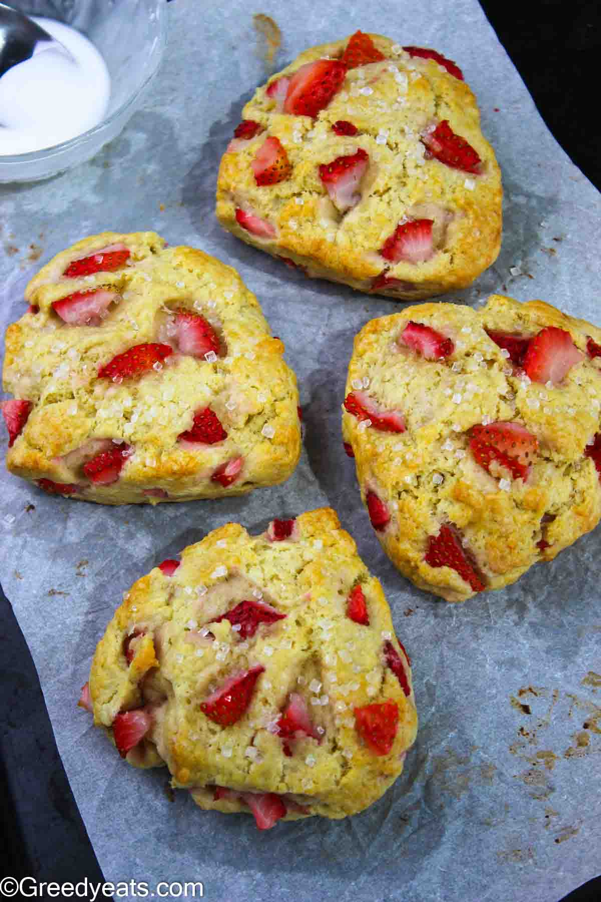 Soft and fresh homemade Strawberry Scones topped with sparkling sugar.