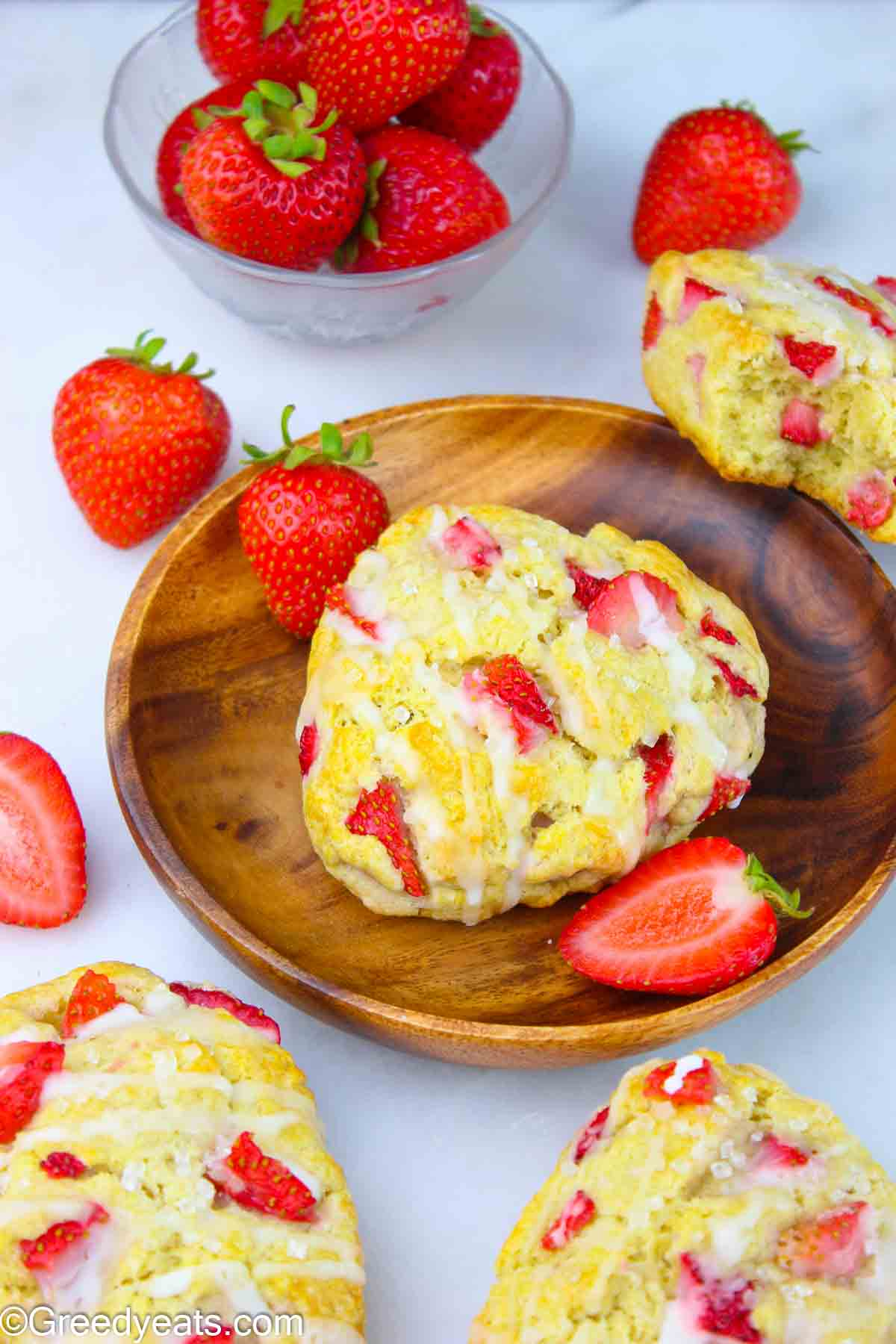 Best Strawberry Scones dotted with fresh Strawberries and topped with sweet vanilla glaze.