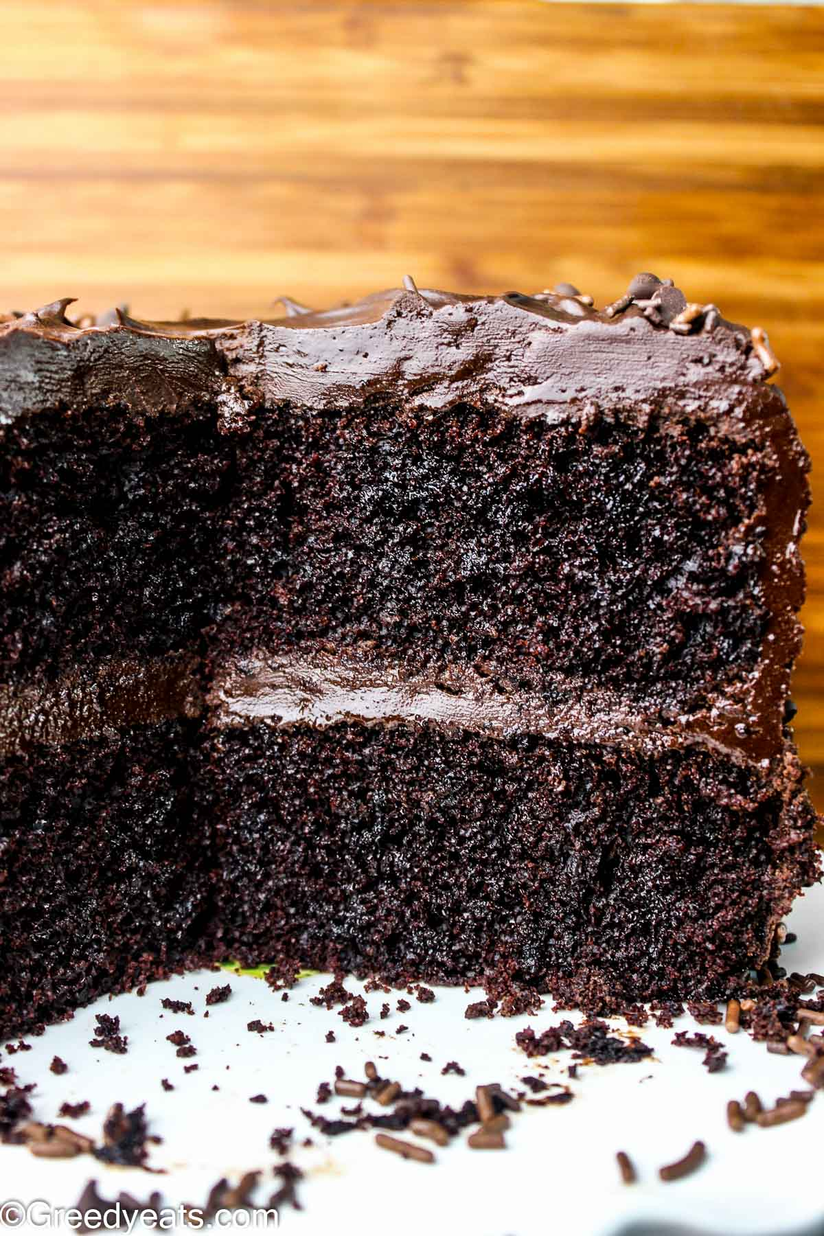 Double layer Chocolate Cake topped with easy chocolate ganache kept on a cake stand.