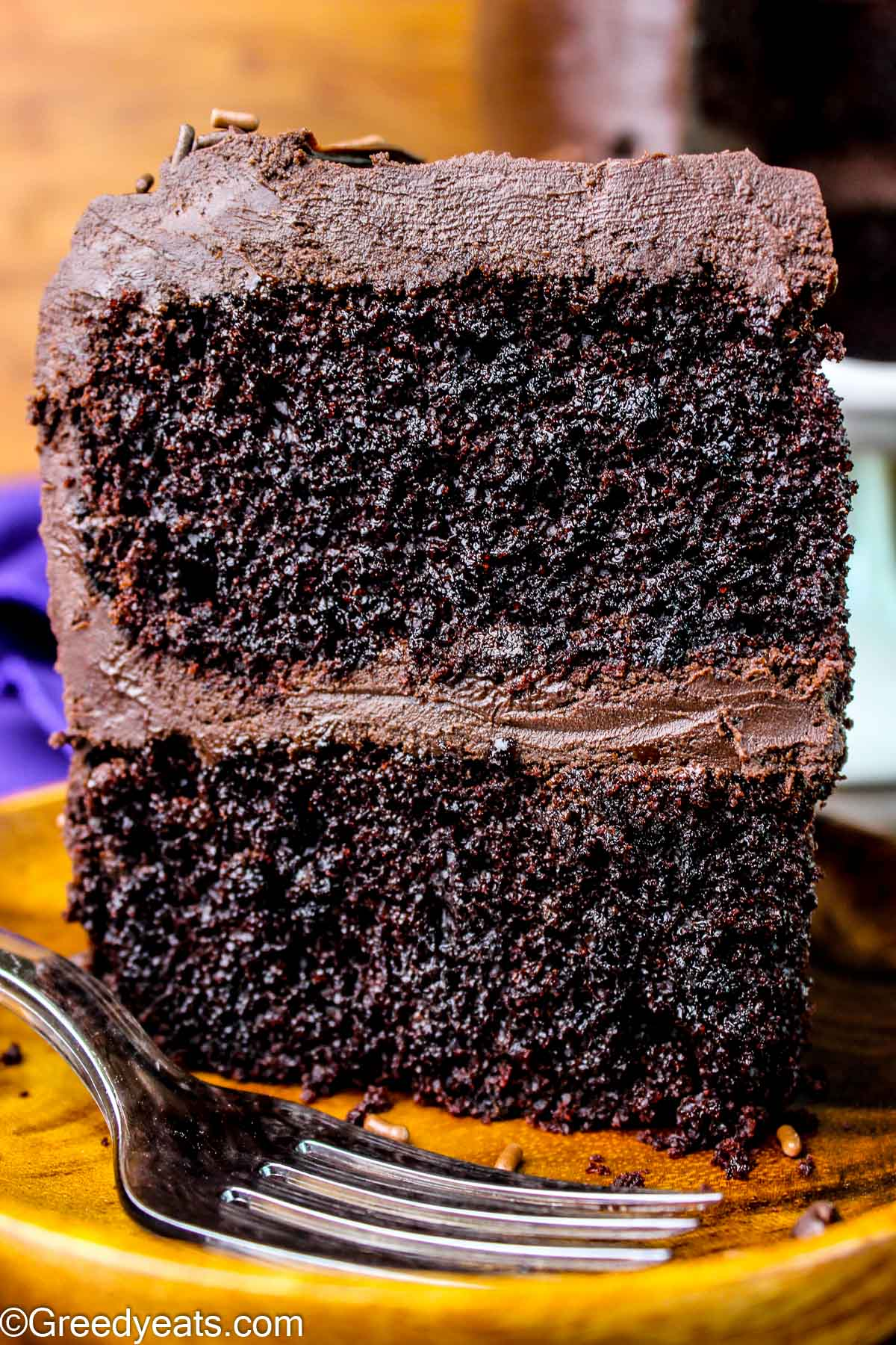 Easy Chocolate Cake Recipe made in one bowl topped with Chocolate Ganache.