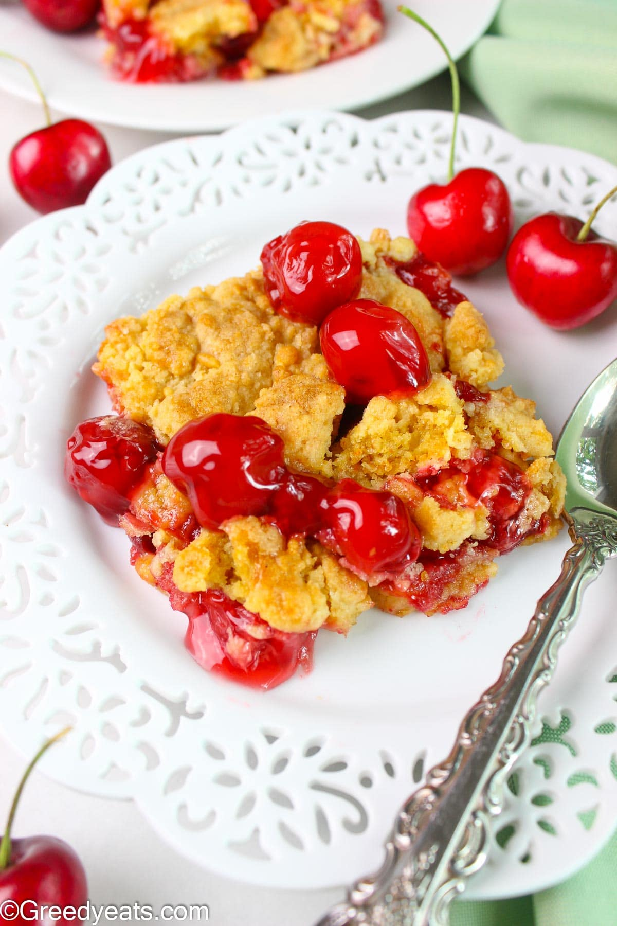 Easy Cherry Dump Cake Recipe with cherry pie filling and crumbles of cake on top.