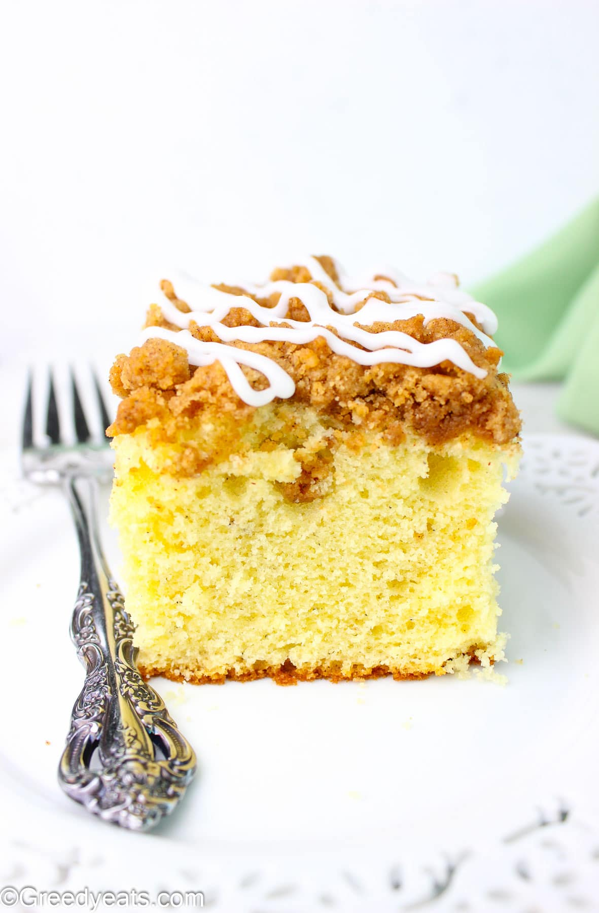 Sour Cream Coffee Cake topped with streusel topping and vanilla glaze!