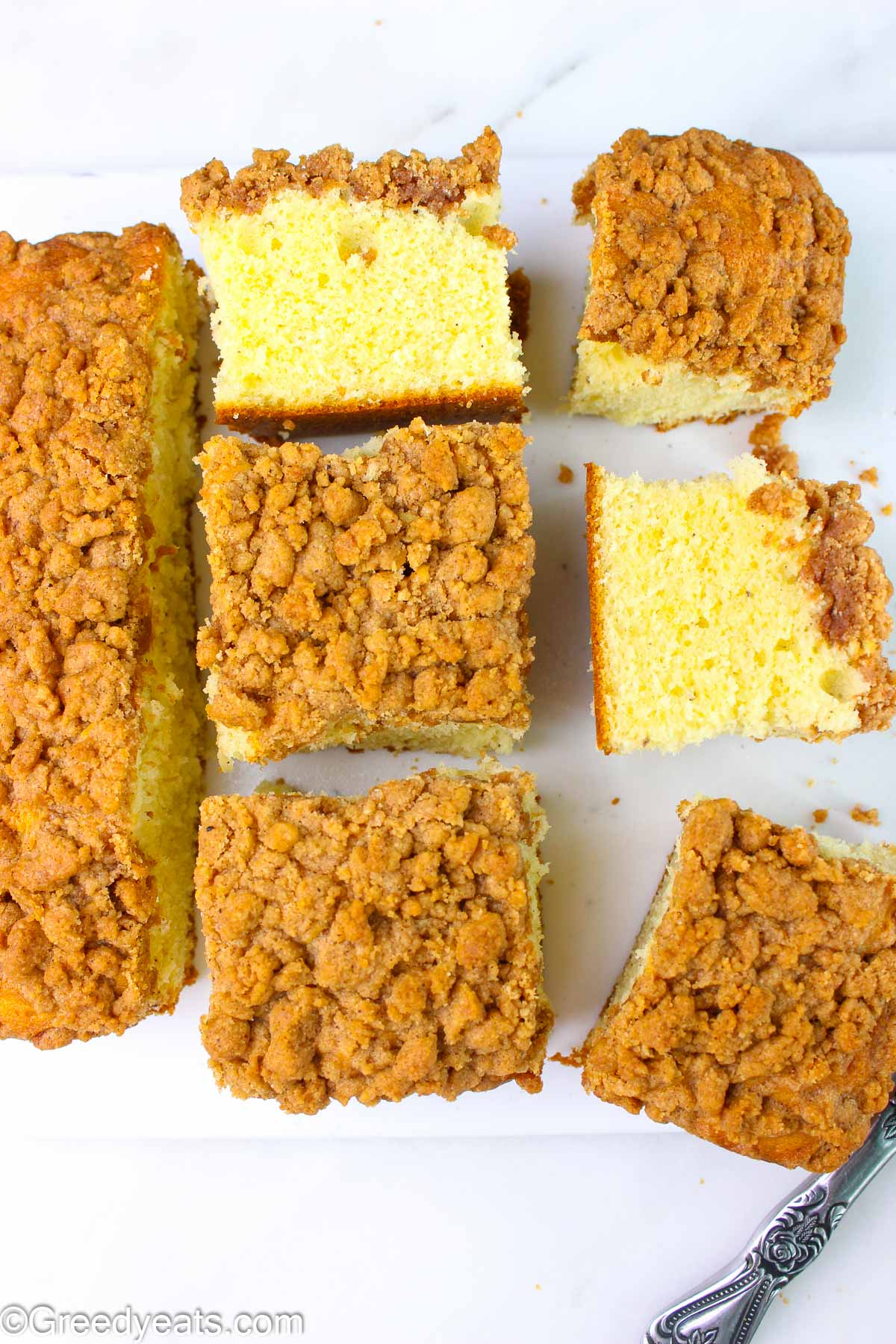 Fluffy homemade Sour Cream Cake topped with crunchy streusel topping
