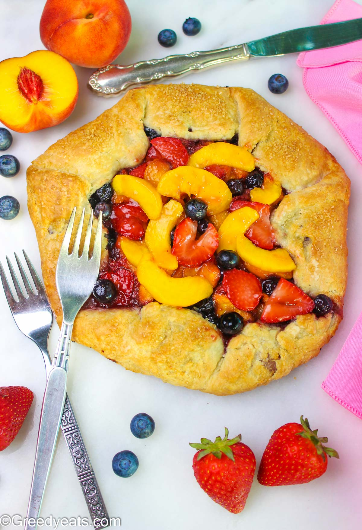 Homemade berry peach Galette is a perfect summer dessert with sweet fruit filling.