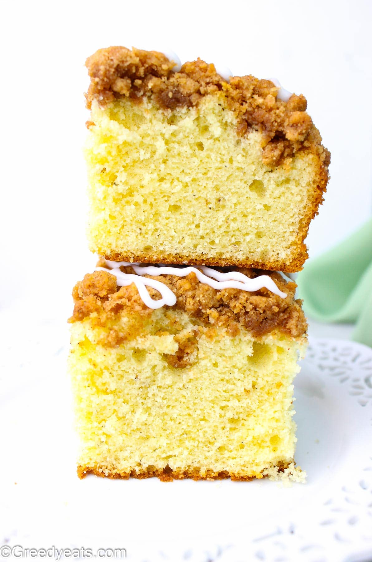 A stack of vanilla glazed coffee cake with Cinnamon streusel topping.