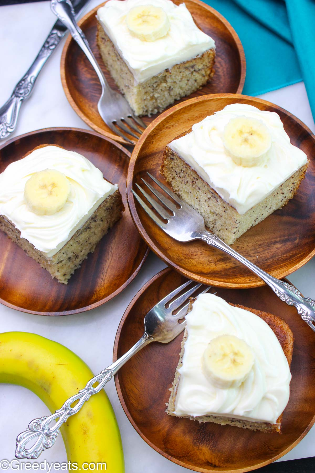 Soft and moist Banana Cake topped with easy cream cheese frosting.