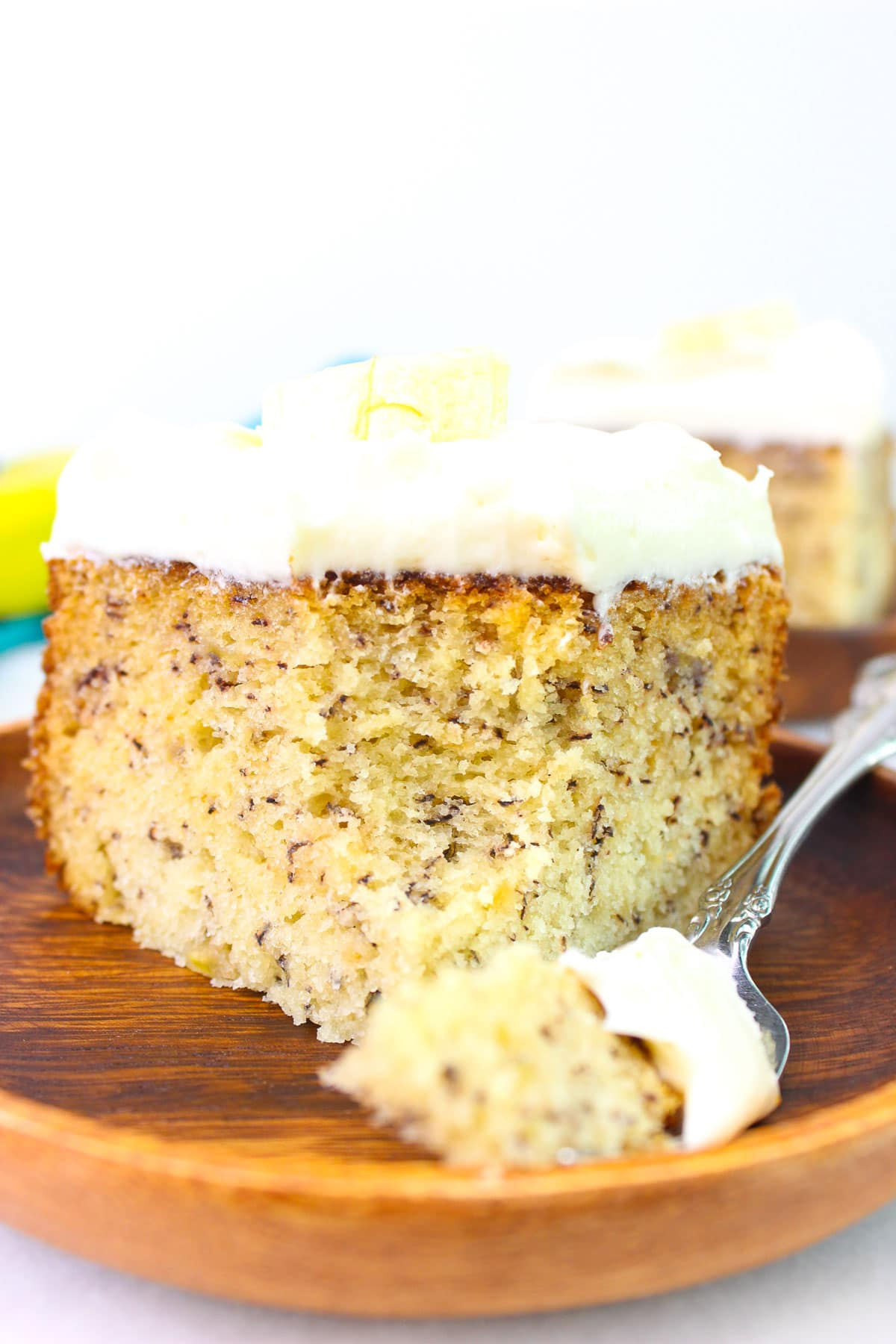 Banana Cake with sour cream, topped with cream cheese frosting and fresh banana slice.