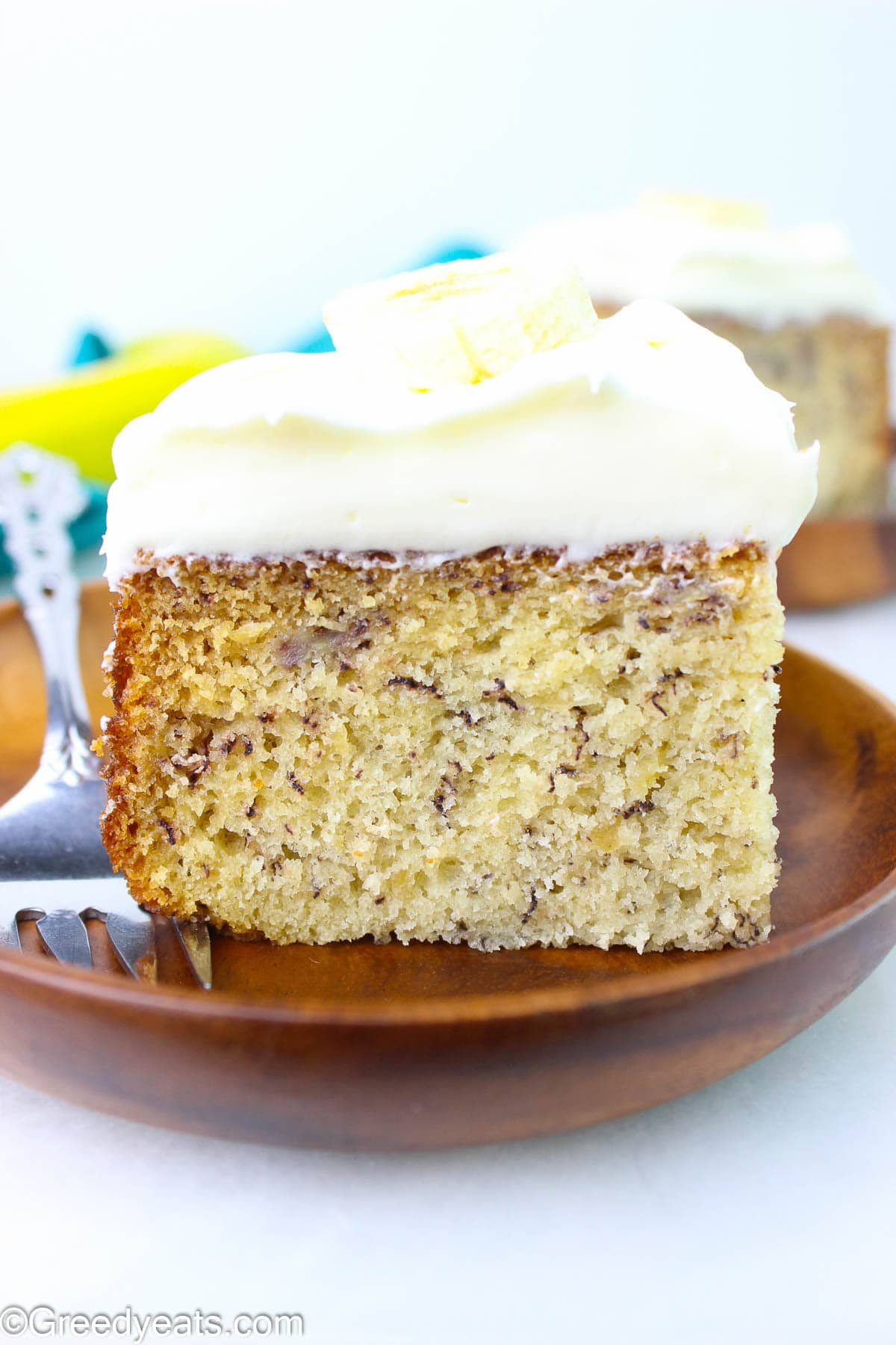 Fluffy, moist, soft and easy Banana Cake recipe topped with thick cream cheese frosting.
