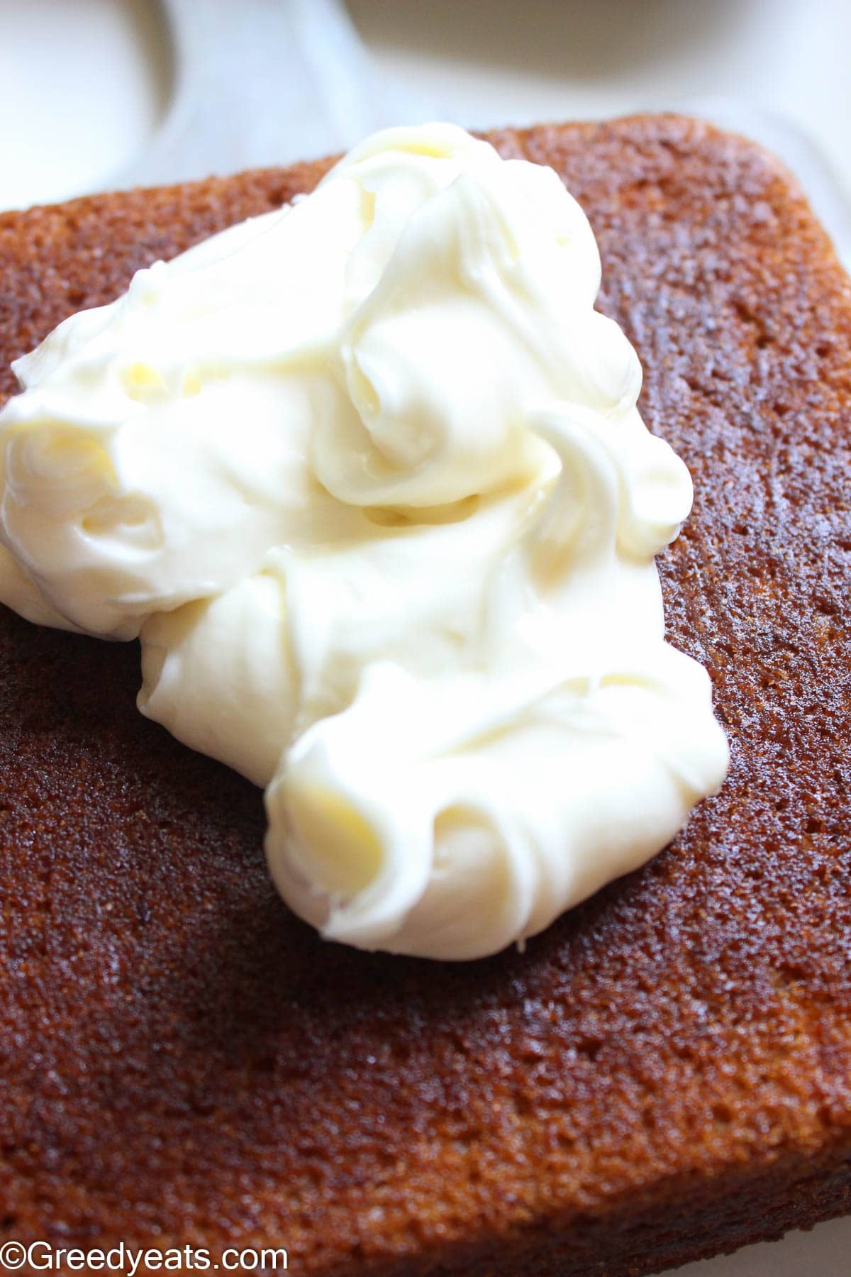 Cooled banana cake topped with thick and creamy cream cheese frosting.