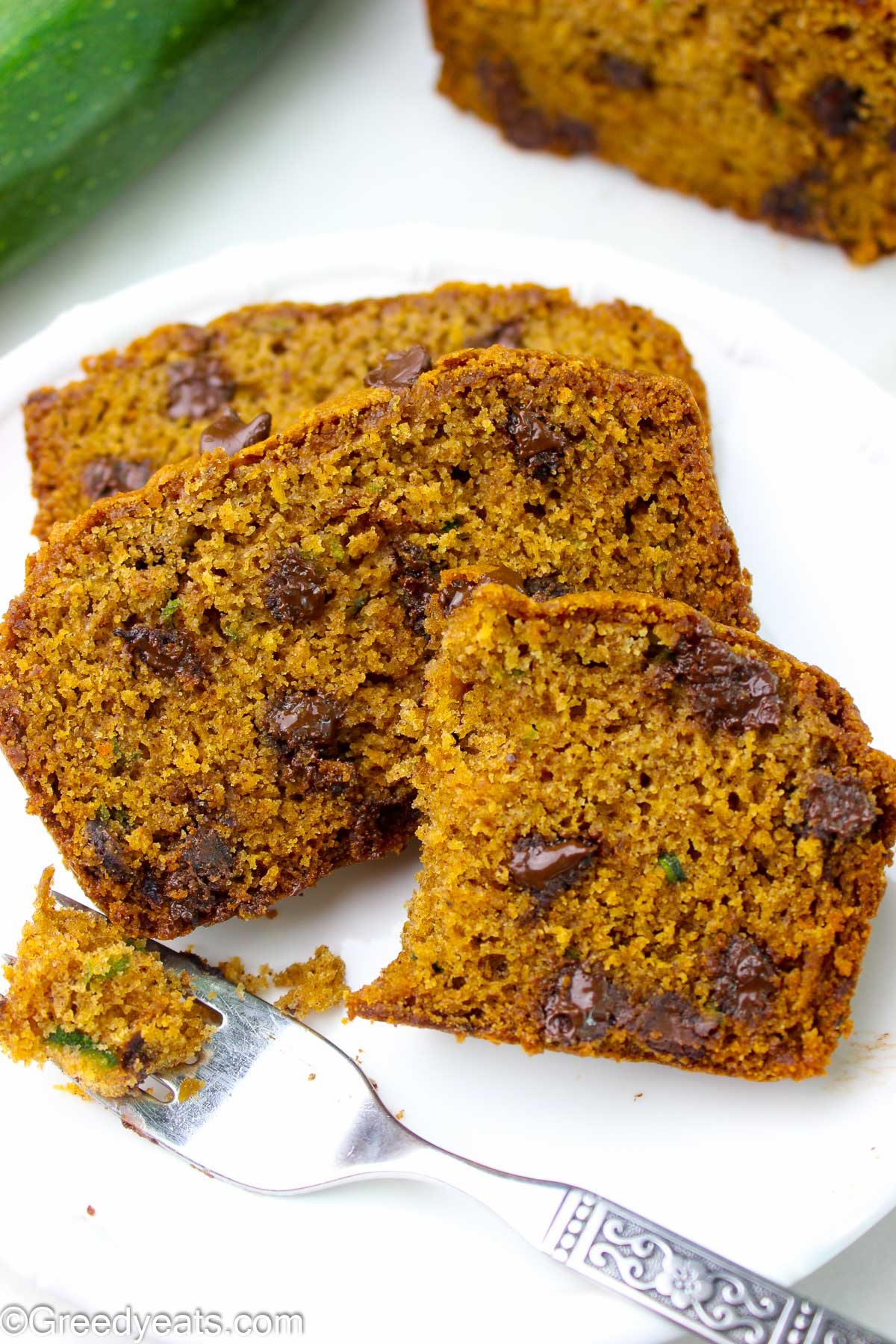 Homemade Zucchini Bread slices filled with aromatic spices and choc chips.