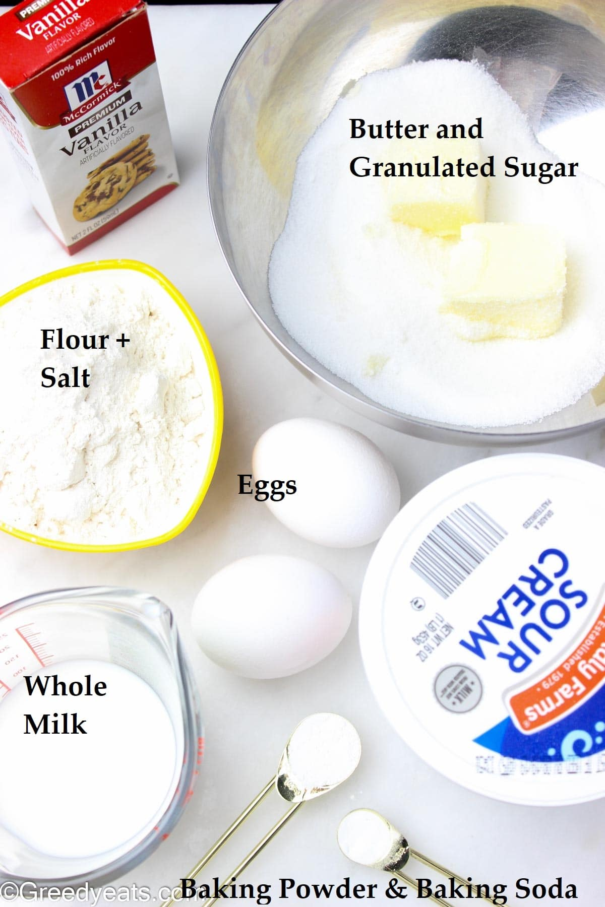 Ingredients like flour, eggs, butter, sour cream, mlik and vanilla to make homemade cake.