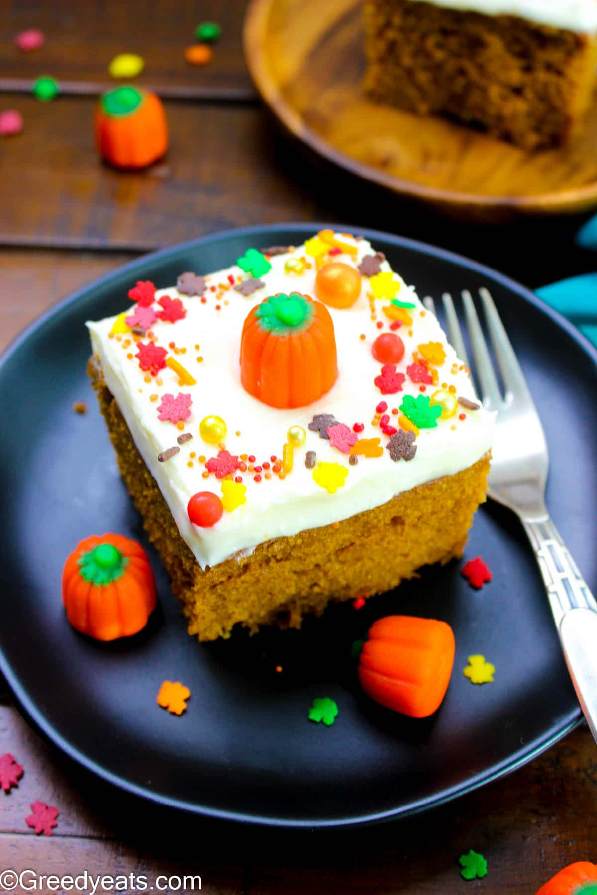 Moist Pumpkin Cake with cream cheese frosting topped with fall sprinkles.