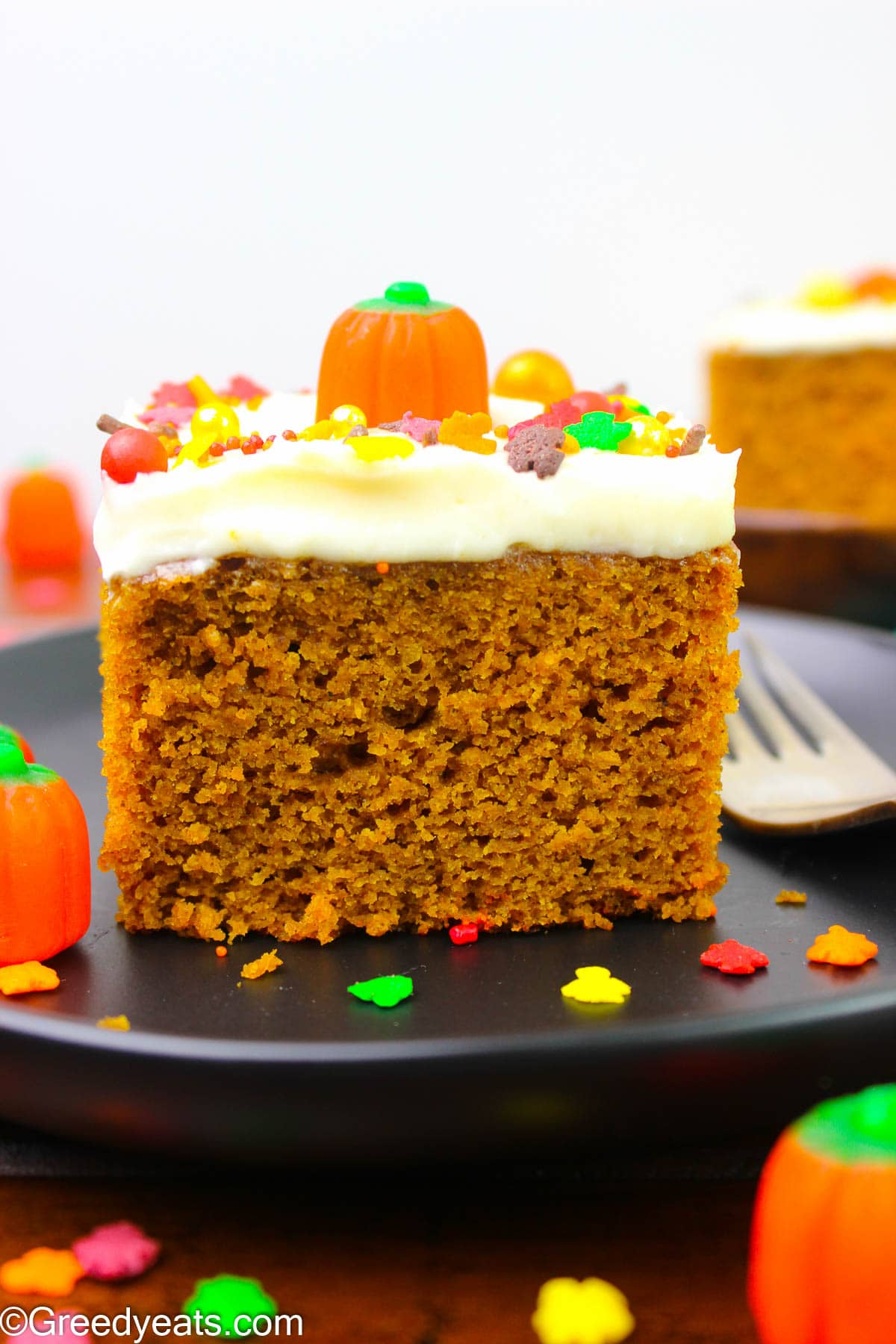 A slice of Moist, tender and soft Pumpkin Cake topped with cream cheese frosting.