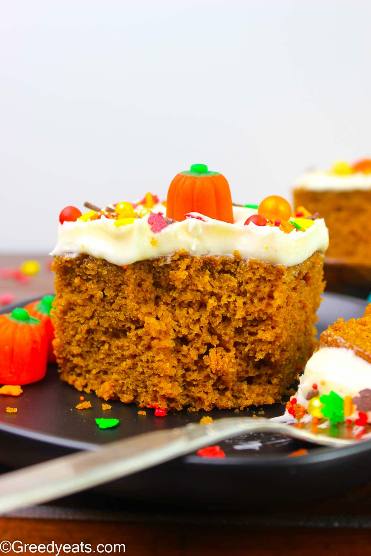 Moist and Easy Pumpkin Cake frosted with Cream Cheese Frosting and topped with fall sprinkles.