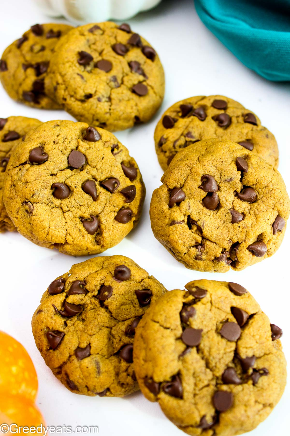 Easy and the best pumpkin cookies with melty chocolate chips kept on a white board.