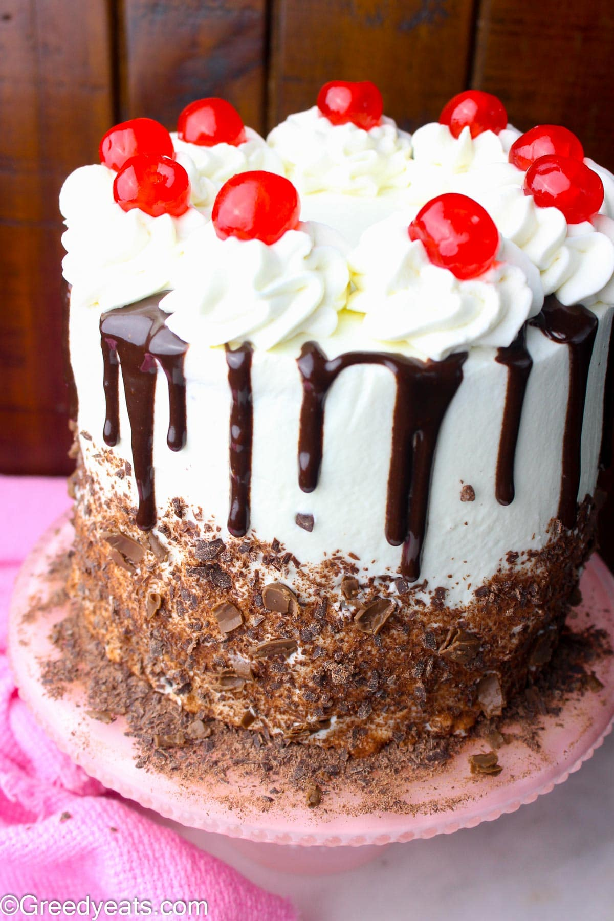 Easy Black Forest Cake Recipe, baked in 6 inch pans, layered with cherries and whipped cream topping.