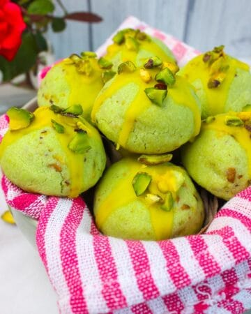 Soft and buttery Pistachio Cookies topped with sweet lemon glaze and finished off with pistachio chunks.